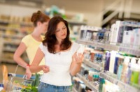 Woman Shopping Looking At Product