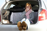Woman drinking coffee in trunk
